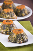 Spinach cakes on white dish. — Stockfoto
