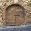 Wooden door. San Gemini. Umbria. Italy. — Stock Photo #13801377