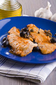Fish fillet with black olives and capers. — Stock Photo