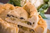 Calzone stuffed with olive and cauliflower — Stock Photo