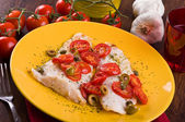 Fish fillet with cherry tomatoes and olive. — Stock Photo