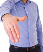 Young business man giving hand. — Stock Photo
