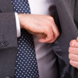 Businessman putting something in his pocket. — Stock Photo
