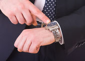 Businessman pointing at his wristwatch. — Stock Photo