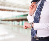 Businessman checking time on his wristwatch. — Stok fotoğraf