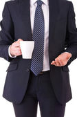 Businessman holding a cup of coffee. — Stock Photo