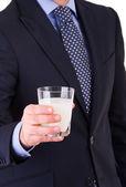 Businessman with glass of milk. — Stock Photo