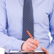 Royalty-Free Stock Photo: Businessman with pen and clipboard.