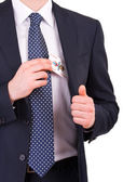 Businessman putting joker card in his pocket. — Stock Photo