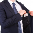 Businessman putting ace card in his pocket. — Stock Photo