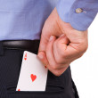 Businessman putting ace card in back pocket. — Stock Photo