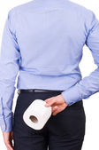 Businessman holding toilet paper behind his back. — Photo