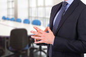 Businessman gesturing with both hands. — Stock Photo