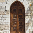 Wooden door. Assisi. Umbria. Italy. — Stock Photo