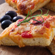 Focaccia with tomato and black olives. — Stock Photo #8625833