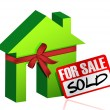 Miniature house with sign of sold or for sale — Stockfoto