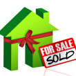Miniature house with sign of sold or for sale - Stock Photo