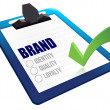 Identity, Quality and Loyalty checklist clipboard — Stock Photo