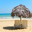 Beach chairs on perfect tropical white sand beach — Stock Photo #25375295