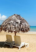 Beach chairs on perfect tropical white sand beach — Stock Photo