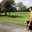 HD: man stretching outdoors - lunge. back view. — Stock Video