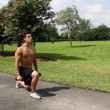 HD: man stretching outdoors - lunge. front view. — Stock Video