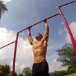 Stock Video: Leg lifts. outside environment. Gym training
