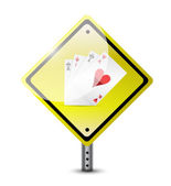 Risk ahead. playing cards road sign concept — Foto de Stock