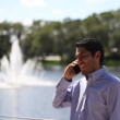 Happy businessman talking at phone. walking — Stockvideo