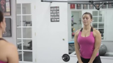 Woman working out doing squats — Video Stock
