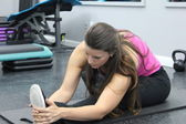 Female athlete stretching warming and stretching — ストック写真