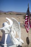 Cemetery in the country with flag — Stock Photo