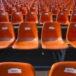 Stock Photo: Orange Seats with numbers