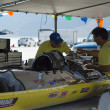 Vesco crew members working on their racing car during the World of Speed at Bonneville Salt Flats — Stock Photo