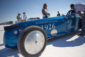 The Radford racing car and the crew members around during the World of Speed at Bonneville Salt Flats — Stock Photo