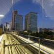 Tokyo trainyard and skyline - Stock Photo