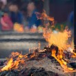 Prayers burning incense sticks in fire - Stock Photo