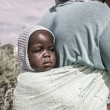 Stock Photo: Portrait on baby carried by her mother, Botswana