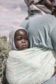 Portrait on a baby carried by her mother, Botswana — Stock Photo