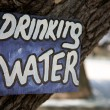 Drinking water signboard in a campsite — Stock Photo