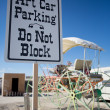 Sign and a trailer in the desert — Stock Photo