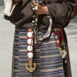 Dress detail of a Tibetan woman in Lhasa — Stock Photo