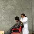 Hairdresser working in the street — Stock Photo