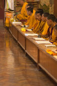 Group of monks praying — Stock Photo