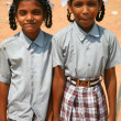 Sisters walking back from school in India — Stock Photo