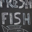A Handwritten sign promoting fresh fish — Foto Stock