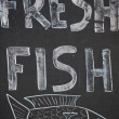 A Handwritten sign promoting fresh fish — 图库照片