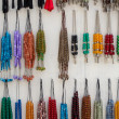 Colorful fake necklaces in a local shop — Stock Photo
