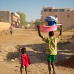 Kids walking in the street of Mopti — Stock Photo #29474989