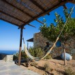 Terrace and close-up from a typical facade at Folegandros. — Stock Photo #29476319